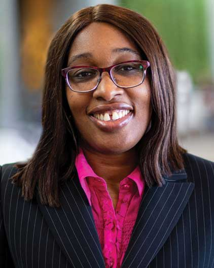 African American woman with business suit smiling